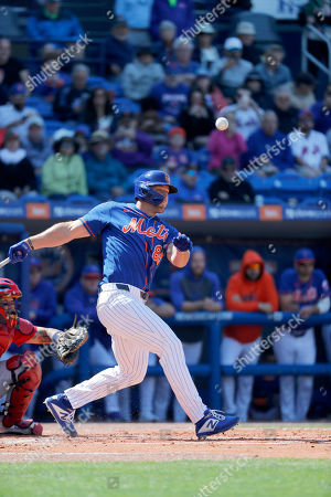 New York Mets' Tim Tebow fouls off a pitch during the second inning of a spring training baseball game against the St. Louis Cardinals, in Port St. Lucie, Fla
