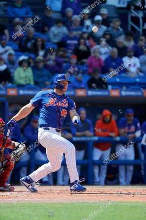 Stock Picture of New York Mets' Tim Tebow fouls off a pitch during the second inning of a spring training baseball game against the St. Louis Cardinals, in Port St. Lucie, Fla