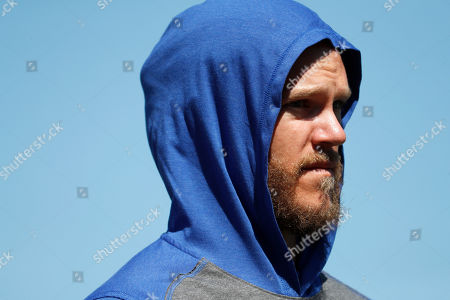 New York Mets pitcher Noah Syndergaard is seen before the start a spring training baseball game against the St. Louis Cardinals, in Port St. Lucie, Fla