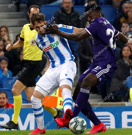 Stock Photo of Real Sociedad's Adnan Januzaj (L) in action against Real Valladolid's Mohamed Karim (R) during a Spanish LaLiga soccer match between Real Sociedad and Real Valladolid at Reale Arensa stadium in San Sebastian, Basque Country, northern Spain, 28 February 2020.