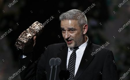 Stock Picture of French producer Swann Arlaudon on behalf of South Korean director Bong Joon-Ho, who won the Best Foreign award for 'Parasite' during the 45th annual Cesar awards ceremony held at the Salle Pleyel concert hall in Paris, France, 28 February 2020.