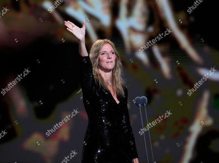 Sandrine Kiberlain, the President of the Cesar award ceremony gestures as it opens in Paris. The Cesar awards are the French equivalent of the Oscars