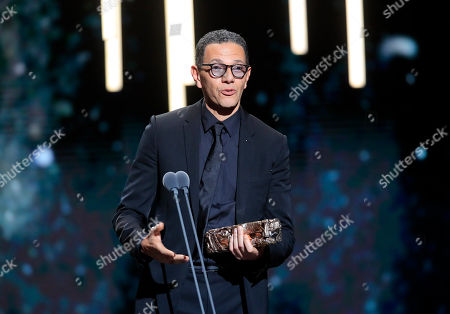 "Roschdy Zem celebrates after winning the Cesar for best actor for his role in ""Roubaix, a light"" on in Paris. The Cesar awards ceremony for France is the equivalent of the Oscars"