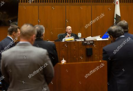 "Stock Image of Judge Larry P. Fidler, middle, considers a defense motion during a hearing at Los Angeles Superior Court on . Sentencing for a man convicted of two murders who prosecutors dubbed ""The Boy Next Door Killer"" has been delayed over a defense motion for a new trial. Judge Fidler had been expected to give a death sentence Friday to 44-year-old Michael Gargiulo, who was found guilty of the home-invasion killings of two women, including one who was about to go out with actor Ashton Kutcher"