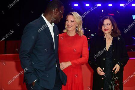 Omar Sy, Virginie Efira and Director Anne Fontaine arrive for the premiere of 'Police' (Night Shift) during the 70th annual Berlin International Film Festival (Berlinale), in Berlin, Germany, 28 February 2020. The movie is presented in the Berlinale Special section at the Berlinale that runs from 20 February to 01 March 2020.