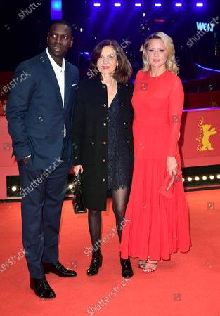 Omar Sy, director Anne Fontaine and Virginie Efira arrive for the premiere of 'Police' (Night Shift) during the 70th annual Berlin International Film Festival (Berlinale), in Berlin, Germany, 28 February 2020. The movie is presented in the Berlinale Special section at the Berlinale that runs from 20 February to 01 March 2020.