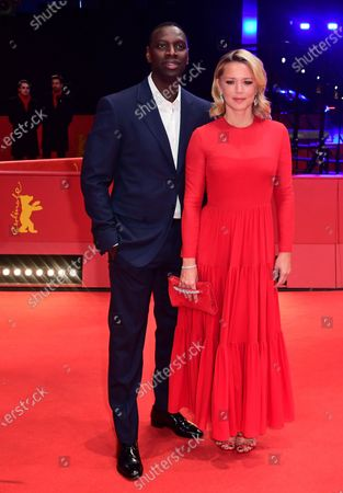 Omar Sy and Virginie Efira arrive for the premiere of 'Police' (Night Shift) during the 70th annual Berlin International Film Festival (Berlinale), in Berlin, Germany, 28 February 2020. The movie is presented in the Berlinale Special section at the Berlinale that runs from 20 February to 01 March 2020.