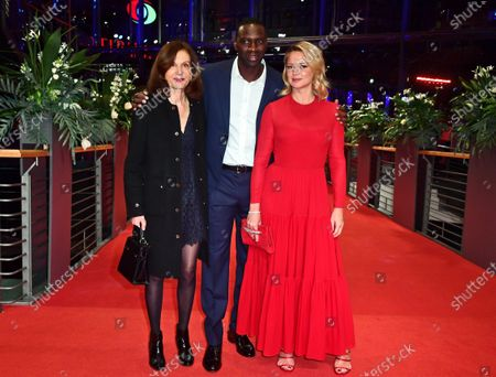 Anne Fontaine, Omar Sy and Virginie Efira arrive for the premiere of 'Police' (Night Shift) during the 70th annual Berlin International Film Festival (Berlinale), in Berlin, Germany, 28 February 2020. The movie is presented in the Berlinale Special section at the Berlinale that runs from 20 February to 01 March 2020.