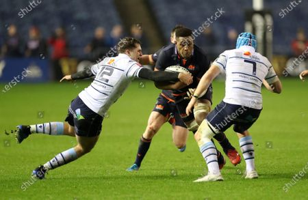 Bill Mata of Edinburgh is tackled by Ben Thomas as he takes on Olly Robinson (7).