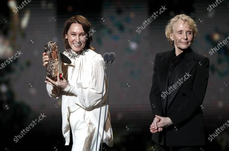 Emmanuelle Bercot (L) flanked by Claire Denis holds the Best Director Award on behalf of Roman Polanski (not pictured) during the 45th annual Cesar awards ceremony held at the Salle Pleyel concert hall in Paris, France, 28 February 2020.