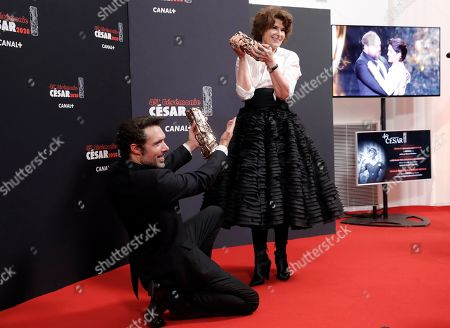 Nicolas Bedos and Fanny Ardant pose with photographers holding their trophies respectively Best Original Screenplay award and Best Actress in a Supporting Role award for the movie 'La Belle epoque', in Paris. The Cesar awards ceremony for France is the equivalent of the Oscars
