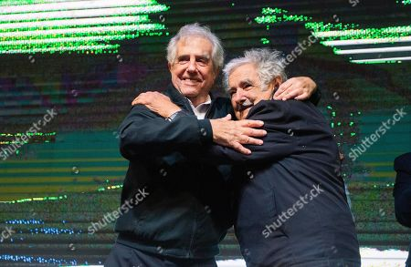 Uruguay's outgoing President Tabare Vazquez, left, embraces former President Jose Mujica, during a farewell party as the leftist government coalition ends its 15-year era in power, in Montevideo, Uruguay, . President-elect Luis Lacalle Pou will be sworn-in as the country's new president on Sunday
