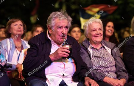Stock Image of Uruguay's former President Jose Mujica sips mate accompanied by his wife, Lucia Topolansky, at a farewell party for outgoing President Tabare Vazquez as the leftist government coalition ends its 15-year era in power, in Montevideo, Uruguay, . President-elect Luis Lacalle Pou will be sworn-in as the country's new president on Sunday