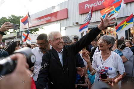 Uruguay's outgoing President Tabare Vazquez arrives for a farewell party as the leftist government coalition ends its 15-year era in power, in Montevideo, Uruguay, . President-elect Luis Lacalle Pou will be sworn-in as the country's new president on Sunday