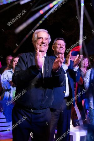Uruguay's outgoing President Tabare Vazquez, left, and his Foreign Minister Rodolfo Nin Novoa, applaud during a farewell party as the leftist government coalition ends its 15-year era in power, in Montevideo, Uruguay, . President-elect Luis Lacalle Pou will be sworn-in as the country's new president on Sunday