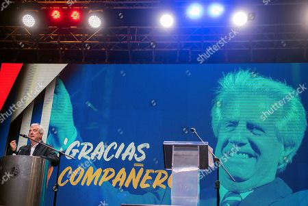 Uruguay's outgoing President Tabare Vazquez speaks to supporters during a farewell party as the leftist government coalition ends its 15-year era in power, in Montevideo, Uruguay, . President-elect Luis Lacalle Pou will be sworn-in as the country's new president on Sunday