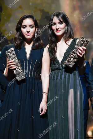 Lyna Khoudri with the best female newcomer award for 'Papicha' and Anais Demoustier with the best actress award for 'Alice et le Maire' pose on stage during the Cesar Film Awards 2020 Ceremony At Salle Pleyel