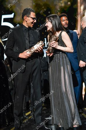 Roschdy Zem with the best actor award and Anais Demoustier with the best actress award pose on stage during the Cesar Film Awards 2020 Ceremony At Salle Pleyel