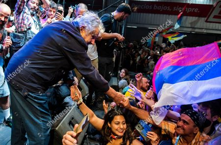 Uruguay's former President Jose Mujica greets supporters during a farewell party for otgoing President Tabare Vazquez as the leftist government coalition ends its 15-year era in power in Montevideo, Uruguay, . President-elect Luis Lacalle Pou will be sworn-in as the country's new president on Sunday