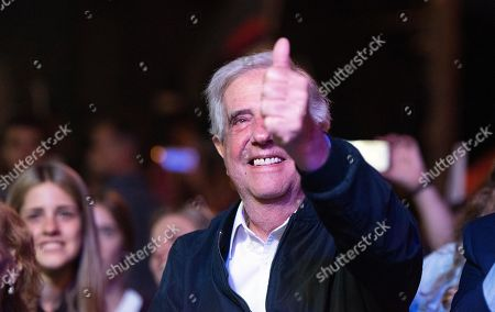 Uruguay's outgoing President Tabare Vazquez flashes a thumbs up at supporters during a farewell party as the leftist government coalition ends its 15-year era in power, in Montevideo, Uruguay, . President-elect Luis Lacalle Pou will be sworn-in as the country's new president on Sunday