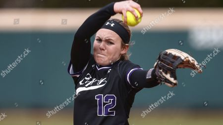 Lipscomb's Megan Gray throws to a batter during an NCAA softball game against SIU Edwardsville, in Nashville, Tenn