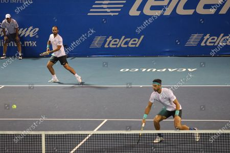 Colombian tennis players Juan Sebastian Cabal (L) and Robert Farah (R) in action against French tennis players Fabrice Martin and Adrian Mannarino during a Men's Doubles semi-final at the Mexican Open in Acapulco, Mexico, 28 February 2020.