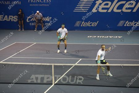 Colombian tennis players Juan Sebastian Cabal (R) and Robert Farah (L) in action against French tennis players Fabrice Martin and Adrian Mannarino during a Men's Doubles semi-final at the Mexican Open in Acapulco, Mexico, 28 February 2020.