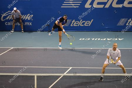French tennis players Fabrice Martin (L) and Adrian Mannarino (R) in action against Juan Sebastian Cabal and Robert Farah of Colombia during a Men's Doubles semi-final at the Mexican Open in Acapulco, Mexico, 28 February 2020.
