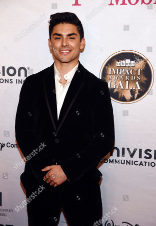 Diego Tinoco poses at the 2020 Impact Awards at the Beverly Wilshire Hotel, in Beverly Hills, Calif