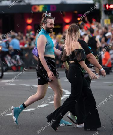 US media personality Jonathan Van Ness (L) participates in the 42nd annual Gay and Lesbian Mardi Gras parade in Sydney, Australia, 29 February 2020.