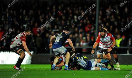 Jono Ross of Sale Sharks tackles Ben Morgan of Gloucester Rugby