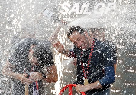 The British SailGP team spray champagne on their skipper Ben Ainslie as they celebrate winning the first leg of the series in Sydney, . Britain beat Australia in the final match race