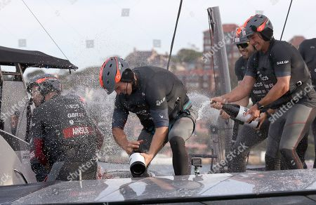 The British SailGP team spray the skipper, Ben Ainslie, left, with champagne as they celebrate winning the first leg of the series in Sydney, . Britain beat Australia in the final match race