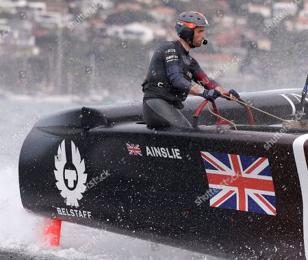 Skipper Ben Ainslie steers the boat as the British team slow after crossing the finish line in the second fleet race of the SailGP series in Sydney, . Britain beat Australia in the final match race
