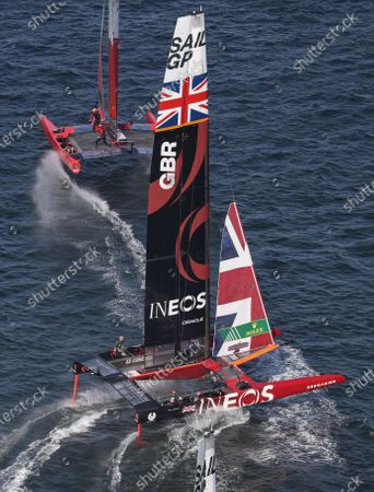 Spain SailGP Team helmed by Phil Robertson and Great Britain SailGP Team helmed by Ben Ainslie in action during racing on day 1. Sydney SailGP, Event 1 Season 2 in Sydney Harbour, Sydney, Australia. 28 February 2020. Photo: David Gray for SailGP. Handout image supplied by SailGP