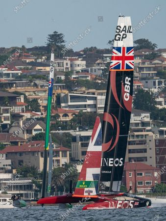 Great Britain SailGP Team helmed by Ben Ainslie leads Australia SailGP Team helmed by Tom Slingsby in the final match race on Race Day 2. Sydney SailGP, Event 1 Season 2 in Sydney Harbour, Sydney, Australia. 29 February 2020. Photo: Bob Martin for SailGP. Handout image supplied by SailGP