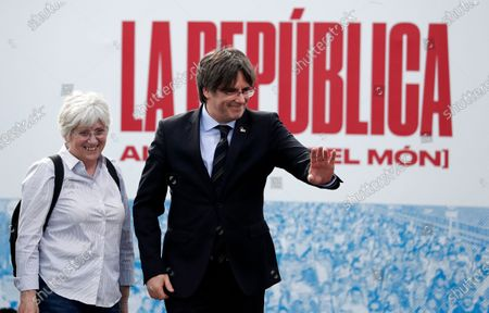 Former Catalan leader Carles Puigdemont (R) waves next to former Counselor of Education of Catalonia Clara Ponsati i Obiols (L) during a political rally in Perpignan, Southwest France, 29 February 2020.