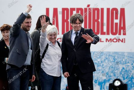 Former Catalan leader Carles Puigdemont (R) waves next to former Counselor of Education of Catalonia Clara Ponsati i Obiols (2-R) during a political rally in Perpignan, Southwest France, 29 February 2020.