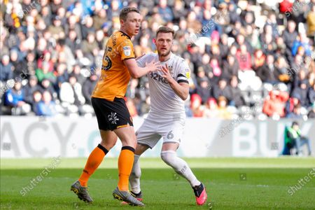 Leeds United defender Liam Cooper (6)  during the EFL Sky Bet Championship match between Hull City and Leeds United at the KCOM Stadium, Kingston upon Hull