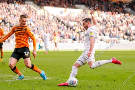 Leeds United midfielder Jack Harrison (22), on loan from Manchester City, shoots during the EFL Sky Bet Championship match between Hull City and Leeds United at the KCOM Stadium, Kingston upon Hull