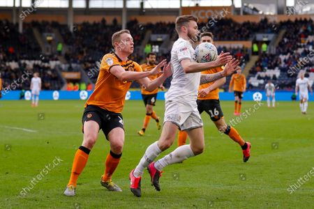 Leeds United defender Stuart Dallas (15)  during the EFL Sky Bet Championship match between Hull City and Leeds United at the KCOM Stadium, Kingston upon Hull