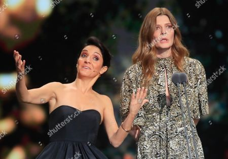 French comedian Florence Foresti and French actress Chiara Mastroianni speaks on stage during the Cesar Award ceremony after being awarded for the Best Film with 'Les Miserables' on in Paris. The Cesar awards ceremony for France is the equivalent of the Oscars