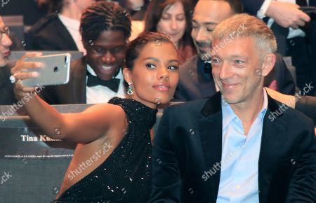 French actor Vincent Cassel, left, smiles as her daughter model Tina Kunakey takes a selfie during the Cesar Award ceremony after being awarded for the Best Film with 'Les Miserables' on in Paris. The Cesar awards ceremony for France is the equivalent of the Oscars