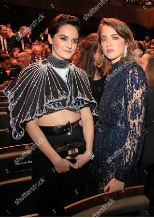 Stock Photo of Noemie Merlant, left, and Adele Haene pose for photographers during the Cesar Award ceremony after being awarded for the Best Film with 'Les Miserables' on in Paris. The Cesar awards ceremony for France is the equivalent of the Oscars