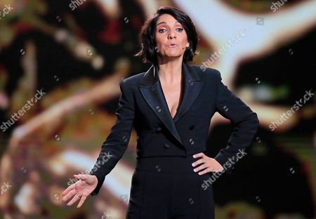 French comedian Florence Foresti speaks on stage during the Cesar Award ceremony after being awarded for the Best Film with 'Les Miserables' on in Paris. The Cesar awards ceremony for France is the equivalent of the Oscars