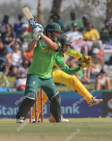South African batsman David Miller plays a shot while Australian wicketkeeper Alex Carey watches on during the ODI cricket match between South Africa and Australia in Paarl, South Africa