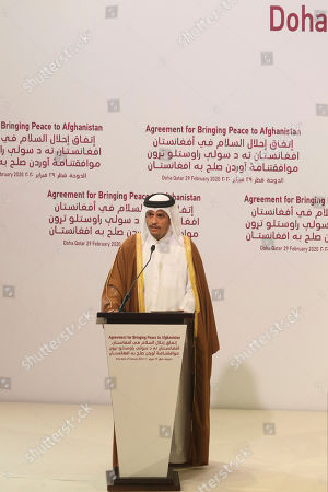 Qatar's Deputy Prime Minister and Foreign Minister Sheikh Mohammed bin Abdulrahman bin Jassim Al-Thani speaks during the agreement signing between Taliban and U.S. officials in Doha, Qatar, . The United States is poised to sign a peace agreement with Taliban militants on Saturday aimed at bringing an end to 18 years of bloodshed in Afghanistan and allowing U.S. troops to return home from America's longest war