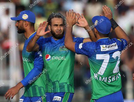 Multan Sultans spinner Imran Tahir celebrates on the dismissal of Quetta Gladiators batsman Shane Watson during their Pakistan Super League T20 cricket match in Multan, Pakistan