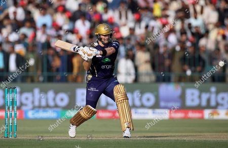 Quetta Gladiators batsman Shane Watson plays a shot during the Pakistan Super League T20 cricket match against Multan Sultans, in Multan, Pakistan
