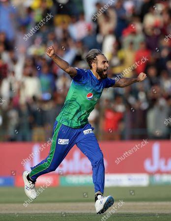 Stock Picture of Multan Sultans spinner Imran Tahir celebrates on the dismissal of Quetta Gladiators batsman Shane Watson during their Pakistan Super League T20 cricket match in Multan, Pakistan